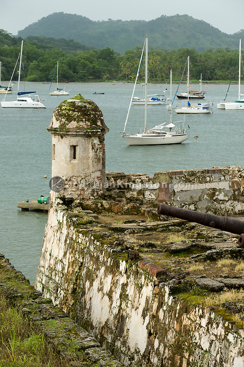 Spanish cannon rests on the wall of Fort Santiago, Portobelo, Panama.