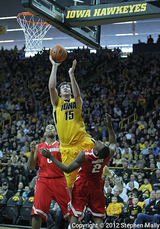 January 07, 2011: Iowa Hawkeyes forward Zach McCabe (15) puts up a shot over Ohio State Buckeyes guard Jordan Sibert (2) during the the NCAA basketball game between the Ohio State Buckeyes and the Iowa Hawkeyes at Carver-Hawkeye Arena in Iowa City, Iowa on Saturday, January 7, 2012.