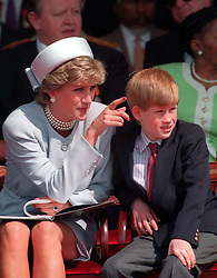 "Embargoed to 0001 Monday August 21 File photo dated 07/05/95 of Diana, Princess of Wales with her son Prince Harry. Diana, Princess of Wales was a woman whose warmth, compassion and empathy for those she met earned her the description the ""people's princess""."