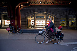 A woman on a bicycle passes by one of the many diamond shops on Pelikaanstraat, in the heart of the diamond district, in Antwerp, Belgium, on Thursday, Oct. 22, 2009. (Photo © Jock Fistick)