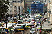 Africa. Kenya. Nairobi city centre. Latema Road..Traffic of taxi matatus and buses..CD0010