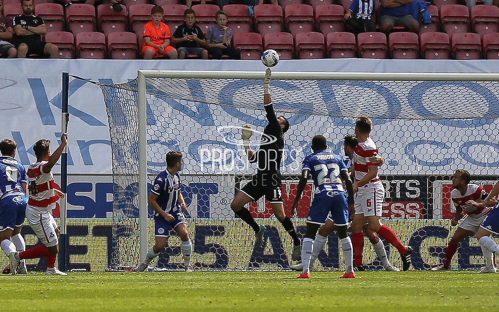 GK Stuckman saves during the Sky Bet League 1 match between Wigan Athletic and Doncaster Rovers at the DW Stadium, Wigan, England on 16 August 2015. Photo by Simon Davies.