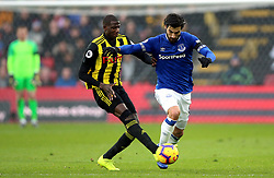 Watford's Abdoulaye Doucoure (left) and Everton's Andre Gomes (right) battle for the ball during the Premier League match at Vicarage Road, Watford.