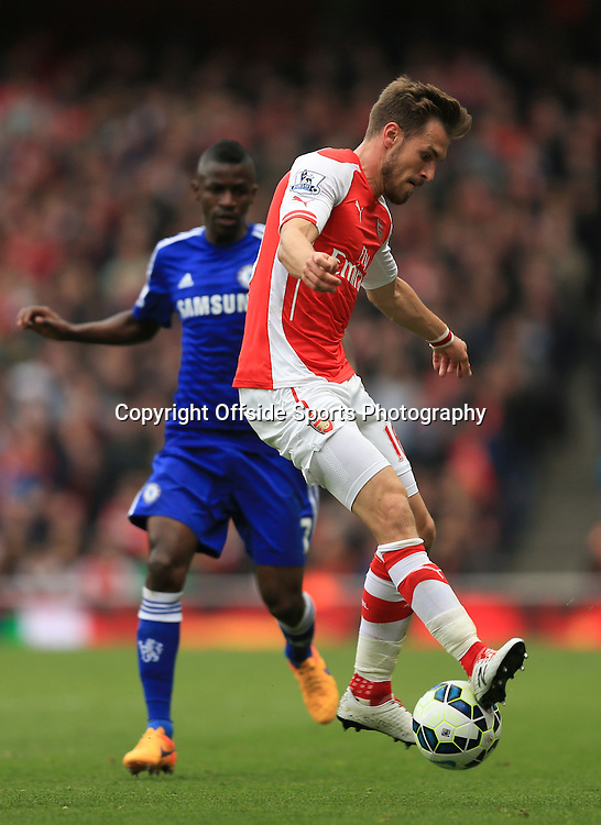 26 April 2015 - Barclays Premier League - Arsenal v Chelsea - Aaron Ramsey of Arsenal tangles with Ramires of Chelsea - Photo: Marc Atkins / Offside.