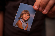 "Max Andrew Janssen holds a photo of himself at 4.  Max was born Makenzie Ann Janssen on June 20, 1996.  Max is a ""transgender,"" and he began living as a boy two years ago and legally changed his name to Max last year.  Max carries this photo in his wallet, ""That was a part of my life.  As much as sometimes not want to say it, I was socialized female.""  She's a part of who I am now."