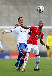 Basel's Yves Kaiser (left) and Manchester United's Joshua Bohui battle for the ball