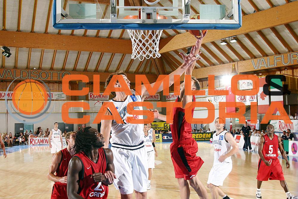 DESCRIZIONE : Bormio Trofeo Internazionale Diego Gianatti Canada Italia <br /> GIOCATORE : Marconato<br /> SQUADRA : Italia <br /> EVENTO : Bormio Trofeo Internazionale Diego Gianatti Canada Italia <br /> GARA : Canada Italia<br /> DATA : 21/07/2006 <br /> CATEGORIA : Rimbalzo<br /> SPORT : Pallacanestro <br /> AUTORE : Agenzia Ciamillo-Castoria/G.Cottini<br /> Galleria : FIP Nazionale Italiana <br /> Fotonotizia : Bormio Trofeo Internazionale Diego Gianatti Canada