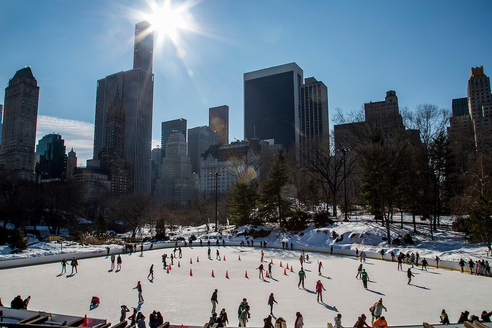 People ice skating around the Wollman Rink in the southern park of Central Park, Manhattan, New York City, New York, United States of America.  Snow surrounds the public ice rink.  (photo by Andrew Aitchison / In pictures via Getty Images)