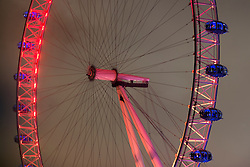 © Licensed to London News Pictures.30/01/2014. London, UK. The London Eye is being lit up with red and gold lights to celebrate the Chinese New Year. Photo credit : Peter Kollanyi/LNP