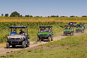 03 SEPTEMBER 2020 - RADCLIFFE, IOWA: SONNY PERDUE, left, first four wheeler, tours a farm in central Iowa. Perdue, the US Secretary of Agriculture, made a secretarial disaster declaration for 42 counties in central Iowa during a farm visit in central Iowa Thursday. Perdue was accompanied by Governor Kim Reynolds and US Senator Joni Ernst. The secretarial disaster declaration frees up more federal funds, from the Department of Agriculture, to help in recovery from the derecho storm that wiped out about one-third of Iowa's corn crop on Monday, August 10, 2020. Many Iowa farmers are still rebuilding lost buildings or plowing under lost crops.    PHOTO BY JACK KURTZ