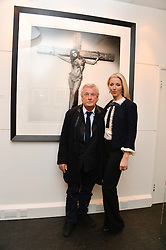 TERRY O'NEILL and TAMARA BECKWITH at a private view of photographs 'Terry O'Neill-The Best Of' held at The Little Black Gallery, 13A Park Walk, London on 16th January 2014.