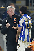 Hull City manager Steve Bruce jests with Fernando Forestieri of Sheffield Wednesday  during the Sky Bet Championship match between Hull City and Sheffield Wednesday at the KC Stadium, Kingston upon Hull, England on 26 February 2016. Photo by Ian Lyall.