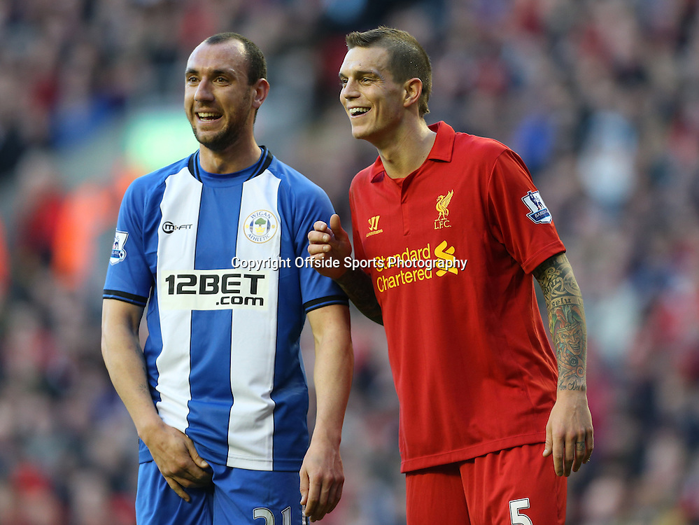 17th November 2012 - Barclays Premier League - Liverpool vs. Wigan Athletic - Daniel Agger of Liverpool joes with Ivan Ramis of Wigan - Photo: Simon Stacpoole / Offside.
