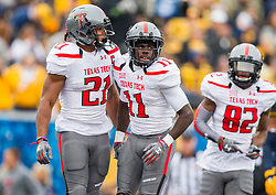 Nov 7, 2015; Morgantown, WV, USA; Texas Tech Red Raiders wide receiver Jakeem Grant celebrates with Texas Tech Red Raiders running back DeAndre Washington after scoring a touchdown during the first quarter against the West Virginia Mountaineers at Milan Puskar Stadium. Mandatory Credit: Ben Queen-USA TODAY Sports