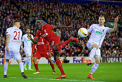 LIVERPOOL, ENGLAND - Thursday, February 25, 2016: Liverpool are awarded a penalty after this challenge between Mamadou Sakho and FC Augsburg's Ragnar Klavan during the UEFA Europa League Round of 32 1st Leg match at Anfield. (Pic by David Rawcliffe/Propaganda)