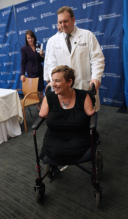 (091212  Boston, MA) Dr. Simon G. Talbot, Surgical Lead on the Hand Transplant Team at Brigham and Women's Hospital assists quadruple amputee Katy Hayes as they leave a news conference announcing that she will receive an arm transplant at Brigham and Women's Hospital, Wednesday,  September 12, 2012.