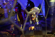 A guest arrives at the Pisani Moretta palace to attend the Ballo del Doge during the carnival in Venice.