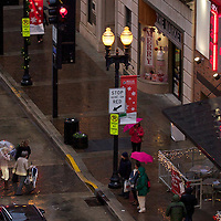 Pedestrians braving the rain in downtown Knoxville, Tennessee.