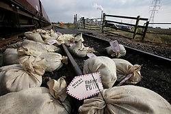 UK ENGLAND COTTAM 23SEP14 - Sacks of coal lie next to a railway line during a protest against coal shipments to the UK.<br /> <br /> Over fifty Greenpeace UK activists stopped a freight train carrying 1,500 tonnes of coal to Cottam power station in Nottinghamshire, England.<br /> <br /> jre/Photo by Jiri Rezac / Greenpeace<br /> <br /> &copy; Jiri Rezac 2014