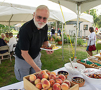 Miller Krauss of Moultonboro is ready to feast on the bounty from Moulton Farm during their Sunday Brunch in the field.  Homemade waffles with fresh blueberries, peach french toast, flannel beet hash as well as traditional scrambled eggs, bacon and sausage, fruit salad with fresh peaches were among the buffet choices.  (Karen Bobotas/for the Laconia Daily Sun)