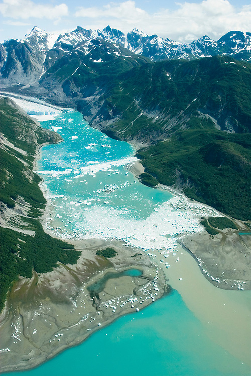 An aerial view of McBride Glacier and Inlet filled with ice and blue water.