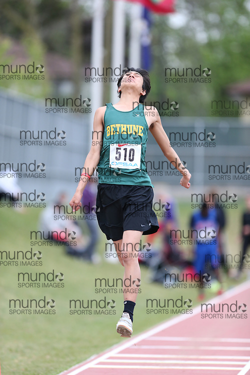Joey Zhou of Dr. Norman Bethune - Agincourt competes in the senior boys long jump at the 2013 OFSAA Track and Field Championship in Oshawa Ontario, Thursday,  June 6, 2013.<br /> Mundo Sport Images / Sean Burges