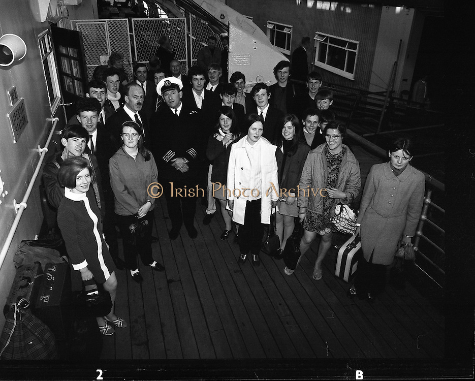 "Gael Linn Debating Competition Winners.<br /> 1970.<br /> 27.05.1970.<br /> 05.27.1970.<br /> 27th May 1970.<br /> A group of children who had taken part in the Gael Linn, National Debating Competition headed to Wales where they were to attend the Eisteddfod Festival. They were aboard the ""Mail Boat"" the M.V.Hibernia.<br /> <br /> Image shows Captain Cyril Jones welcoming the party of children aboard the MV Hibernia."