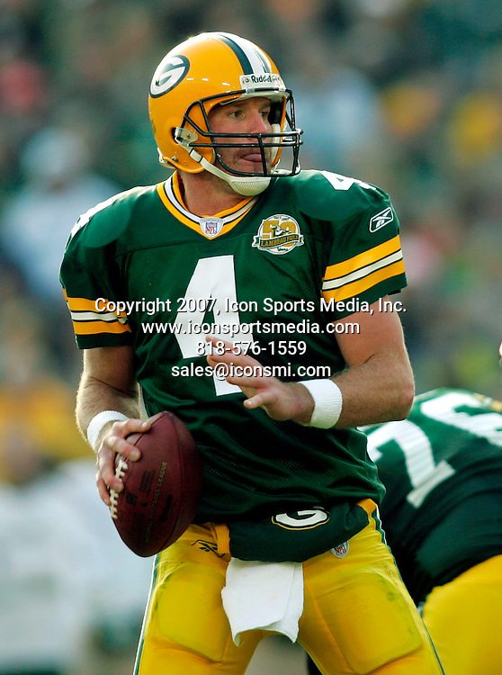 11 November 2007: Green Bay Packers quarterback Brett Favre (4) prepares to pass to wide receiver James Jones for a 37 yard gain against the Minnesota Vikings in the forth quarter of an NFL football game at Lambeau Field in Green Bay, Wisconsin.  The Packers shutout the Vikings 34-0.