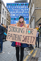 Royal London Hospital, Whitechapel, London. February 10th 2016. Junior doctors picket outside the Royal London hospital as they strike against a proposed new contract that they say will hit their pockets and endanger patient safety. ///FOR LICENCING CONTACT: paul@pauldaveycreative.co.uk TEL:+44 (0) 7966 016 296 or +44 (0) 20 8969 6875. ©2015 Paul R Davey. All rights reserved.