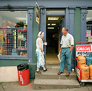 Villagers gossip on the steps of the local newsagents and general store in Monkstown, Co Cork, near the Pfizer factory that manufactures Viagra..