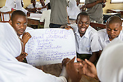 Students at Angaza school working on a group excercise as part of the VSO / ICS Elimu Fursa project (Opportunities in Education) Lindi, Lindi region. Tanzania.