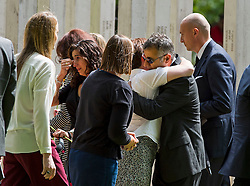 © Licensed to London News Pictures. 07/07/2015. London, UK. Emotional  Family of those who lost their lives and survivors of the attack lay flower at the memorial during the service. A memorial service in Hyde Park London on the 10th anniversary of the 7/7 bombings in London. The event is attended by Prince William, survivors of the attack and family of those who lost their lives. Photo credit: Ben Cawthra/LNP