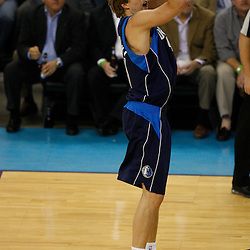 Mar 22, 2010; New Orleans, LA, USA; Dallas Mavericks forward Dirk Nowitzki (41) shoots against the New Orleans Hornets during the first half at the New Orleans Arena. Mandatory Credit: Derick E. Hingle-US PRESSWIRE