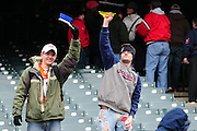 April 7, 2011; Cleveland, OH, USA; Cleveland Indians fans hold up brooms to celebrate the Indian's 3-0 sweep of the series against the Boston Red Sox at Progressive Field. The Indians beat the Red Sox 1-0. Mandatory Credit: Jason Miller-US PRESSWIRE