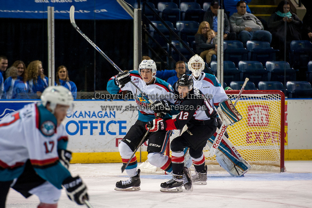 KELOWNA, CANADA - SEPTEMBER 5: Cal Foote #25 of Kelowna Rockets is checked by Jansen Harkins #12 of Prince George Cougars on September 5, 2015 during the first pre-season game at Prospera Place in Kelowna, British Columbia, Canada.  (Photo by Marissa Baecker/Shoot the Breeze)  *** Local Caption *** Cal Foote; Jansen Harkins;