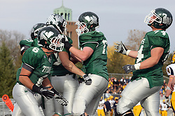 12 November 2011:  Cameron Blossom celebrates in the end zone with Joe Musso, Jeremy Adams and other team mates during an NCAA division 3 football game between the Augustana Vikings and the Illinois Wesleyan Titans in Tucci Stadium on Wilder Field, Bloomington IL