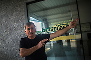 The eldest brother of Jair Bolsonaro, Guido makes the firearms gesture that became the symbol of a belligerent  campaign, in front of his repair shop in Eldorado, south of Sao Paulo, Brazil, Tuesday, Nov. 27, 2018. (Dado Galdieri)