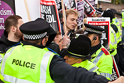 Luton, UK. 5th May, 2012. Police officers hold back supporters of Unite Against Fascism on the We Are Luton/Stop The EDL march who were attempting to confront the far-right English Defence League march at a point at which the routes of the two rival marches converged.