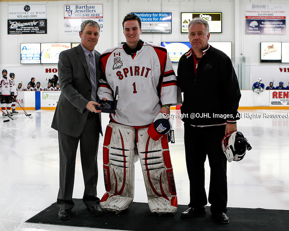 STOUFFVILLE, ON - Jan 10, 2015 : Ontario Junior Hockey League game action between Burlington and Stouffville, Conor Mccollum #1 is presented with the Goalie-of-the-Month award by Izak Westgate and Ken Burrows.<br /> (Photo by Brian Watts / OJHL Images)
