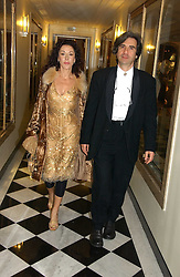 Designer HELEN DAVID and her husband COLIN DAVID at Respoke Bespoke in aid of the Rainforest Foundation held at Claridges, Brook Street, London on 18th October 2006.<br />