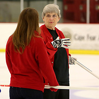 Peggy Hollen, right and Abagail Barman discuss a move during a curling match at the Wilmington Ice House. (Jason A. Frizzelle)