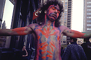On Halloween, NYC, a man is painted like Christ