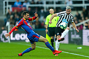 Paul Dummett (#3) of Newcastle United plays a pass around the lunging challenge of James McArthur (#18) of Crystal Palace during the Premier League match between Newcastle United and Crystal Palace at St. James's Park, Newcastle, England on 6 April 2019.