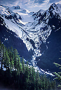 White Glacier flows from Mount Olympus in Washington, USA, seen from Hoh River Trail on May 31, 1982. Mt Tom is on right. Olympic National Park is a UNESCO World Heritage Site.