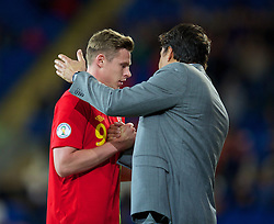 CARDIFF, WALES - Friday, October 11, 2013: Wales' Simon Church and manager Chris Coleman during the 2014 FIFA World Cup Brazil Qualifying Group A match against Macedonia at the Cardiff City Stadium. (Pic by David Rawcliffe/Propaganda)