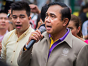 10 JANUARY 2015 - BANGKOK, THAILAND: General PRAYUTH CHAN-OCHA, the Prime Minister of Thailand, sings a Thai pop song during National Children's Day celebrations at Government House in Bangkok. National Children's Day falls on the second Saturday of the year. Thai government agencies sponsor child friendly events and the military usually opens army bases to children, who come to play on tanks and artillery pieces. This year Thai Prime Minister General Prayuth Chan-ocha, hosted several events at Government House, the Prime Minister's office.    PHOTO BY JACK KURTZ