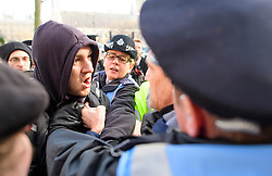 © Licensed to London News Pictures. 05/12/2016. London, UK. Police intervene as a fight breaks out between an anti Brexit supporter (left) and a pro Brexit supporter (centre, obscured by police officer), outside the Supreme Court  in Westminster, London on the first day of a  Supreme Court hearing to appeal against a November 3 High Court ruling that Article 50 cannot be triggered without a vote in Parliament. Photo credit: Ben Cawthra/LNP