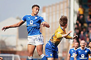 Chesterfield forward Jacob Brown (44) clears with this header during the EFL Sky Bet League 2 match between Chesterfield and Mansfield Town at the Proact stadium, Chesterfield, England on 14 A pril 2018. Picture by Nigel Cole.