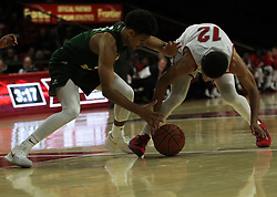 November 14, 2017 - Oxford, Ohio, U.S - Miami (Oh) Redhawks guard Darrian Ringo (12) work on keeping the ball away from a Wright State Raiders player. On Tue Nov 14, 2017 during play at Miami,Ohio in Oxford,Ohio. As the Redhawks go on to beat the Raiders over time 73 to 67. (Credit Image: © Ernest Coleman via ZUMA Wire)
