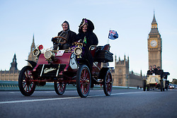 © licensed to London News Pictures. London, UK 03/11/2013. Vehicles cross Westminster Bridge in London with Britain's Houses of Parliament and Big Ben in the background during the 2013 London to Brighton Veteran Car Run on Sunday, November 3, 2013. Over 500 vehicles built before 1905 take part in the annual run which attracts competitors from all over the world. Photo credit: Tolga Akmen/LNP